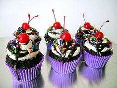 Ice Cream Sundae Cupcakes. Chocolate cupcake filled with chocolate ganache, frosted with vanilla buttercream and a swirl of chocolate ganache, sprinkles and a maraschino cherry.