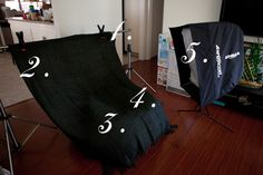Newborn photography setup: backdrop, bean bag, blankets, lighting equipment