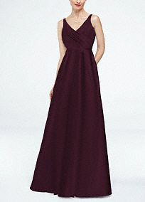 A modern approach to a classic silhouette, your bridesmaids will look elegant in this exquisite gown!  Strapless ruched bodice with ultra-feminine v-neckline.  Long full skirt features trendy side pockets.  Fully lined. Back zip. Imported. Dry clean only.  Available in limited stores.