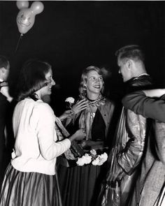 "Sylvia Plath at the Quadigras dance, Smith College, May 1954. Pictured left to right: Sunny Sturtevant, Sylvia Plath and her ""date"", her brother Warren. This beautiful image was taken by D.I. Crossley, class of 1950, professional photographer."