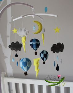 With MUSICAL CRIB ATTACHMENT. Blue, yellow & grey storm chaser musical mobile, clouds, raindrops, lightning, hot air balloons.…