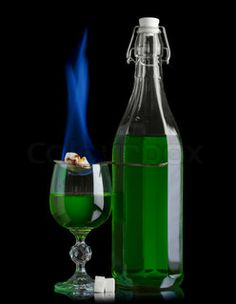 Absinthe bottle and glass with lump sugar burning by Dmytro Sukharevskyy