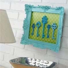 neat idea!  You can frame anything!  Dollar-store forks for the kitchen, used and clean mascara wands painted the same color for the bathroom, pencils all painted the same color, etc. etc.  With a big frame and a piece of glass over it, it'd be a terrific summer serving tray!  Great idea!  --all perfect ideas! I need to recreate at least one of them (: