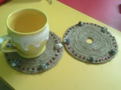 Tea/coffee coaster..made from waste cd decorated with jute thread and shells