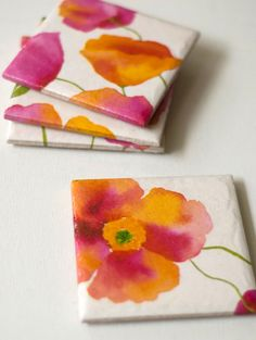 Modpodged napkins on tile--beautiful watercolor look...could also use fabric on tile for coasters or on thin wood pieces to do a wall art piece.....