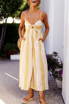 The 'Happy Wanderer Jumpsuit' is an essential piece! It features mustard and white stripe print throughout, v-neckline style with fabric tie up at bust, wide leg style, invisible zipper closure at centre back and thin, adjustable straps for optimal comfort. Details: Material: Polyester Style: Street Pattern Type: Strip