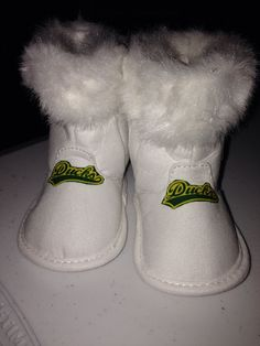 Oregon state ducks baby boots. Etsy.com #loley-pops creations.  Check out for details and creations.
