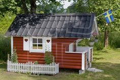 Swedish Garden Hut or Play House with Swedish Flag in Sweden