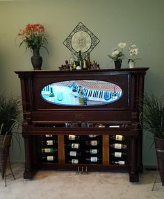 """Turn of the century piano re-purposed into a functional and beautiful """"Piano Bar"""""""