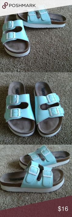 Mukluks blue slip ons sz 6.5 .ladies. The original mukluks. Sz 6.5 blue slip on shoes for ladies. Excellent condition!!! Super comfortable!!! Muk Luks Shoes Sandals