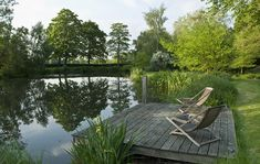 An extensive garden transformation in the romantic tradition uniting a refurbished mill house on the banks of the River Wey, via a series of linked spaces and avenues to a refurbished lake with boathouse and jetties