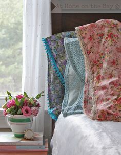 Standard pillowcases trimmed with lace.  How-to with French seams and all.  I just like to look at the pretty florals.  I'll probably never make my own pillow cases!