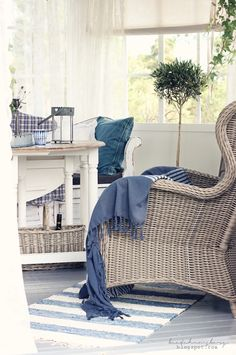 I love the relaxed coastal vibe this lovely rattan chair would provide...now if I just had an ottoman to go with it I could relax very nicely-open the window & hear the ocean, feel the breeze & just relax...