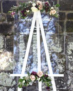 What better way to Find your Seat? Elegant acrylic signage and classic calligraphy. #weddingideas #weddingsigns #acrylicsigns #seatingchart #findyourseat #weddingdecorations