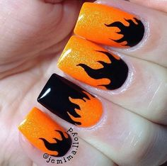 Sparkle orange and black flame Manicure by @jemima.lloyd using our Fire Nail Vinyls found at snailvinyls.com