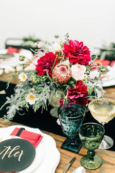 red holiday flowers - photo by Jenna Bechtholt Photography http://ruffledblog.com/surprise-holiday-elopement-brunch