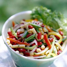 If you like three-bean salad, you'll enjoy this colorful four-bean adaptation. A tangy tarragon vinaigrette provides the flavor for this healthy side dish.