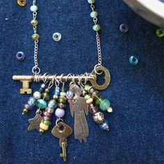 Use a skeleton key as a centerpiece to create a beautiful and unique necklace with hanging beads and trinkets.
