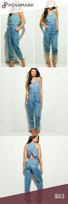 Jumper/romper medium wash denim blue MSRP $72 Summer jumpsuit in a very soft lightweight material 50% cotton 50% tensil. Color- blue denim medium wash( not made out of  denim) Measurements are as follows:Small- bust 17in, waist 15in, hips 18 in,medium-bust 18 in, waist 16 in, hips 19 in,large-bust 19 in, waste 17 in, hips 20 in. All have a 29 inch inseam. All sizes measure 28 inches from shoulder seam to crotch. Gorgeous cut out and flap pockets embellish the back with two more pockets in…