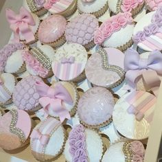 In love with this box 😍💕 #cupcakes #toppers #pink #lilac #ruffles #bow #silver #lace #paint #pearls #chocolategrid #hinarasool #stripes #ribbon #pastel #colours #wedding #party #birthday #instapic #likeforlike #instafood #foodporn #quilt #bridal