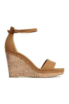 Wedge-heel sandals: Wedge-heel sandals in imitation suede with an ankle strap and adjustable metal buckle, imitation leather linings and insoles and soles in imitation cork and rubber. Platform front 1.5 cm, heel 9.5 cm.
