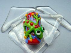 Susan Otto-Bain (Calido Art Glass ) Gecko on red