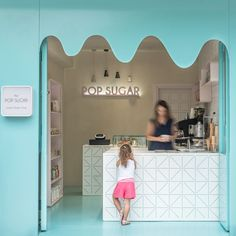 The curvy, blue metallic facade of this sweets store resembles melting chocolate, while the color carries through to the floor and the geometric pattern on the bar, inviting people inside. Café Restaurant, Restaurant Design, Coffee Shop Design, Cafe Design, Design Shop, Design Art, Mini Cafeteria, Deco Cafe, Gelato Shop