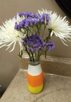 Candy corn milk bottle vase