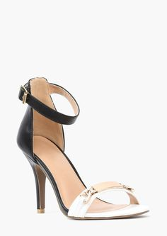 A sexy pair of single strapped pumps! These aren't just any pumps; they have gold embellishment with name tag.