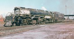 Union Pacific Alco class 1 Big Boy 4-8+8-4 articulated steam locomotive # 4004, is seen in the railroad yard at Laramie, Wyoming, 10-16-1955 by alcomike43, via Flickr