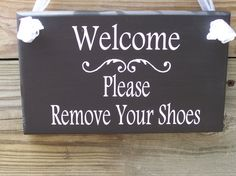 Welcome. Please Remove Your Shoes:   Removing shoes before entering a person's home is a custom practiced by many cultures. In traditional Hindu culture shoes are considered impure. Hindu people believe that Gods reside in their house. All Hindus have a Puja room (prayer room) inside their house and therefore regard their houses as temples. Hence, entering houses in shoes is not an acceptable norm. So, if one is to step inside the house in their shoes, it is a sign of disrespect to the God.