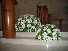 white daisies and green botton in a modern church