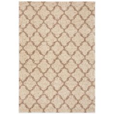 The Prima Shag Temara Lattice Rug from Karastan features a sophisticated, modern style that is accentuated by repeating motifs in elegant neutral colors. The clean geometric patterns provide a rich textural appearance.