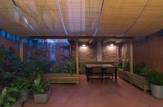 Outdoor space in l'Eixample, Barcelona, designed by FFWD Architects Details: Traditional wood blinds pergola.