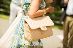 50 Lawn-Party Outfits Gatsby Would Approve #refinery29  http://www.refinery29.com/veuve-clicquot-polo-classic#slide49  A purse roughly the size of three mini-bottles of Veuve is perfect for this event.