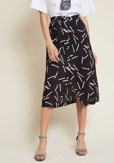 Whether wearing this black midi skirt to kindle afternoon connections or ignite a night out, you're sure to light up the room! With an elasticized-back...