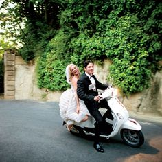 Leave on a vespa! this wedding is where long tables were decorated with olive branches, vases of local herbs, and native fruit and flowers