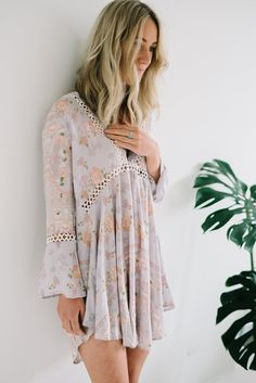 Boho inspired, flared sleeve mini dress.