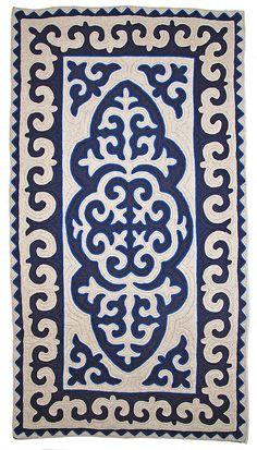 Beautiful blue and white Shyrdak rug from Felt.  http://www.feltrugs.co.uk/