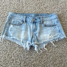American Eagle short shorts These light wash, distressed AE shorts are perfect for summer. They are low-rise and have stud details on the front and back pockets (see pics). Great condition! American Eagle Outfitters Shorts Jean Shorts
