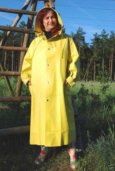 Well protected in her hooded yellow rubber mac