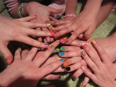 Spin the nail polish bottle.... fun game. i did at emma and ellies birthday party! Whoever it lands on paints one nail that color, and so on.  end up looking like a rainbow! i LOVED it and had so much fun. hey theres me!