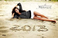 Commemorate your graduation year in the sand. | 47 Brilliant Tips To Getting An Amazing Senior Portrait