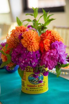 Cincuencenera flowers-zinnias in tomato cans