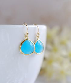 Large Aqua Blue Ocean Blue Drop Earrings. Gold Framed by LeChaim, $19.00