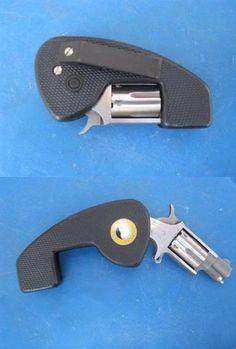 .22 Caliber Folding Pocket Pistol with belt clip : Ain't she cute?