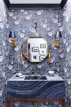 Peony wallpaper lines the walls of this color-happy powder room. | archdigest.com