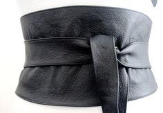 Black leather obi belt is made from real leather with a grainy finish. This beautiful belt will accentuate your style be it casual or formal. Cinch in