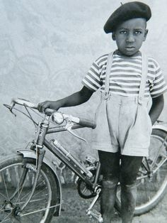 Too cute! The bike, the beret, the suspenders! OH. Photo taken by Seydou Keïta in Mali