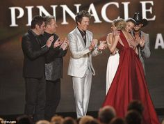 Congratulations: Faith Hill hugged the while (L-R) Jay DeMarcus, Gary LeVox, and Joe Don Rooney of Rascal Flatts and Tim McGraw applauded her Cma Awards, Rascal Flatts, Faith Hill, Miranda Lambert, Tim Mcgraw, Poses For Photos, Country Singers, Her Music, Taylor Swift